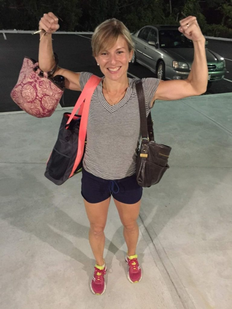 picture of a runner physical therapist flexing her muscles